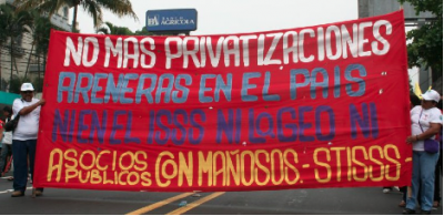 "Salvadoran electrical and municipal workers union leaders will tour the U.S. in February, asking allies to oppose the latest U.S.-backed privatization push in their country. ""No to Public Partnerships With Thieves!"" read one banner at a May Day protest last year. Photo: CISPES."