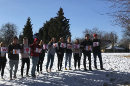 """Denver students held signs spelling out """"We heart teachers."""""""
