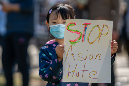 "Little girl holding sign reading ""Stop Asian Hate."""