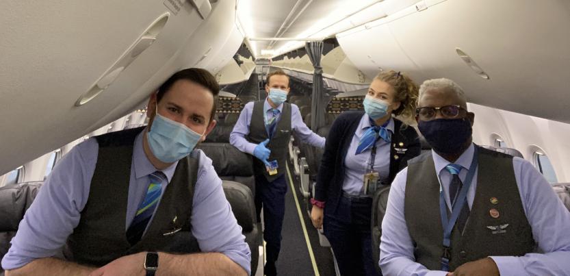 Four Association of Flight Attendants members wear masks on an Alaska Airlines flight.