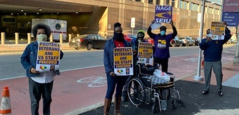 """four protesters hold signs: """"PROTECT VETERANS AND VA STAFF #VACOVID"""" AND """"NAGE SEIU"""""""