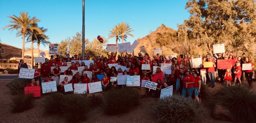 61a899d9 Arizona teachers huddled for a photo following a big protest outside of  Governor Doug Ducey's weekly radio appearance. Photo: Noah Karvelis