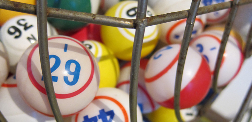 Bingo balls in metal cage