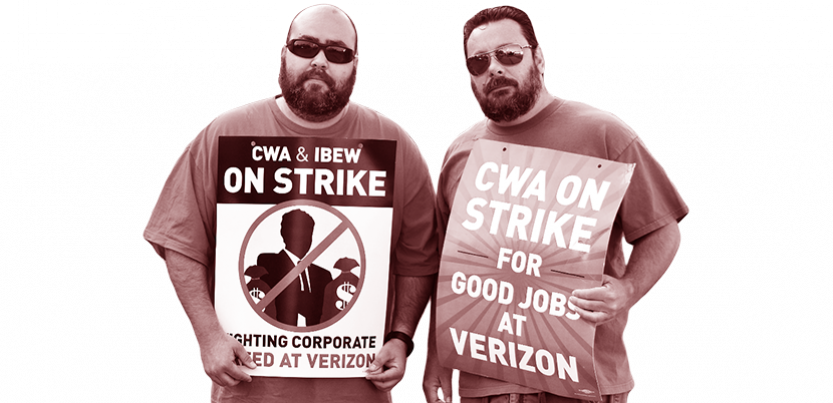 Two workers standing together holding signs.