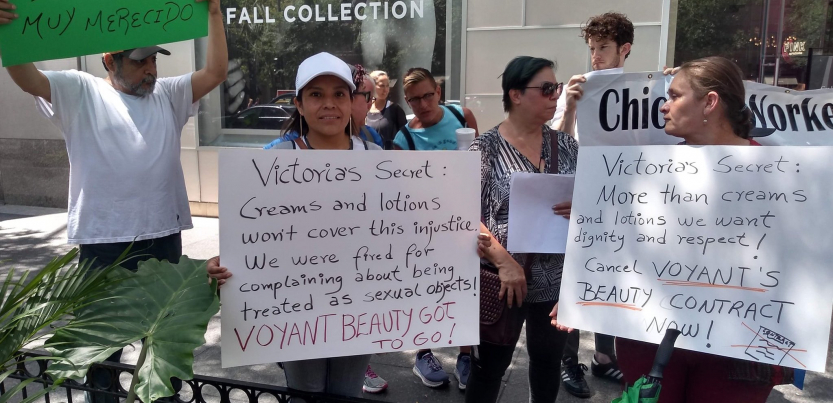 """Voyant Beauty workers demonstrate in front of a Victoria's Secret store in Chicago, holding signs that read: """"Victoria's Secret: Creams and lotions won't cover this injustice. We were fired for complaining about being treated as sexual objects! Voyant Beauty has got to go!"""" and """"Victoria's Secret: More than creams and lotions we want dignity and respect! Cancel Voyant Beauty's contract now!"""""""