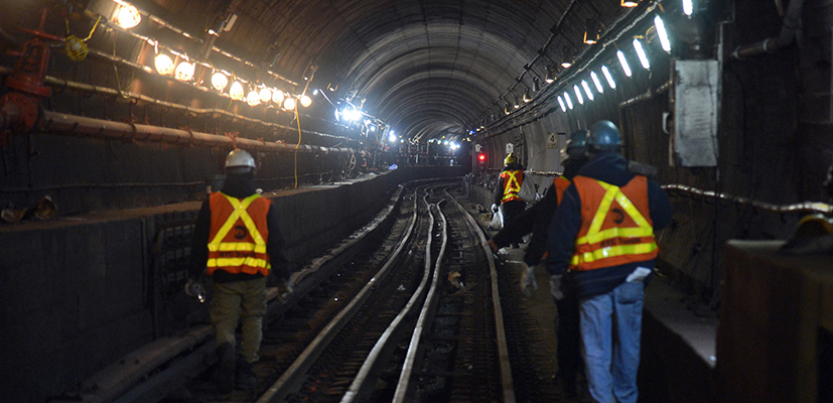 New York City transit workers working in a subway tunnel in 2017.