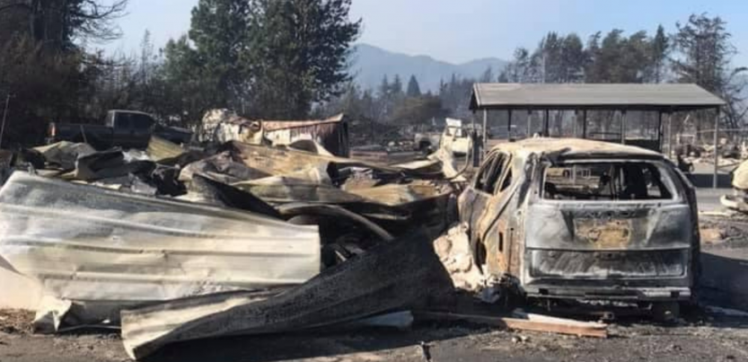 building and vehicle totally destroyed by fire