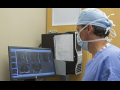 Doctor views imaging machine