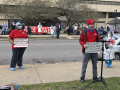 Nurses hold signs and demonstrate outside of Provident Hospital in Chicago.