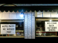 """Signs in shop windows: """"WE'RE BACK! WE MISSED YOU! WELCOME BACK OUTDOOR DINING"""""""