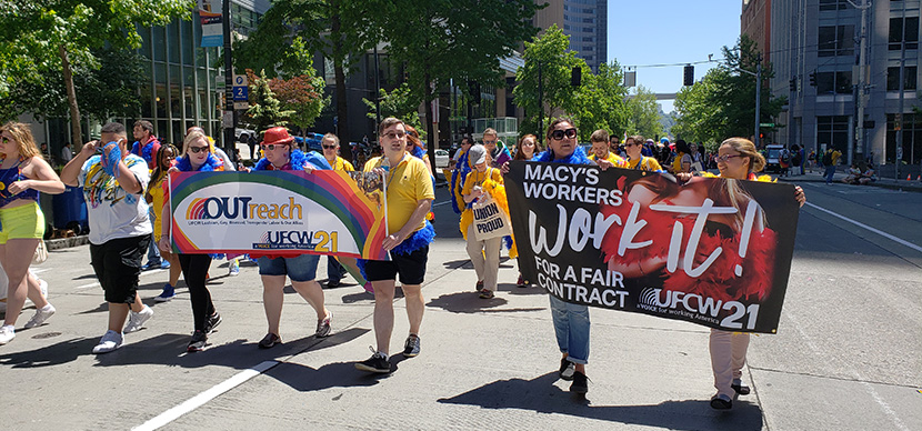 Macy's workers marching for their workplace rights during Seattle's Pride Parade.