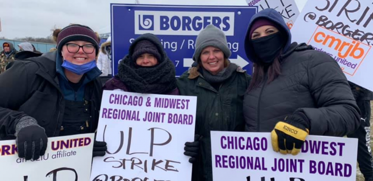 "Workers carry signs reading ""Chicago & Midwest Regional Joint Board, Workers United, ULP strike."" Behind them is ""Borgers"" sign."