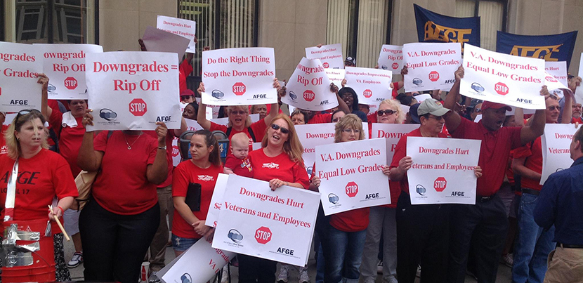 VA AFGE protesters assembled in red with signs