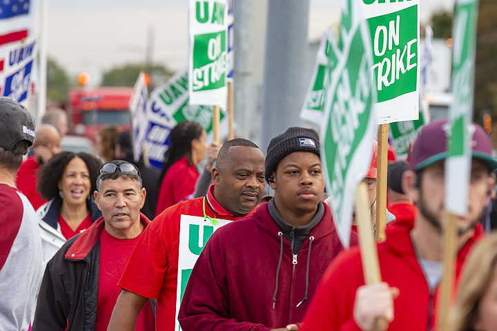 UAW workers marching with picket signs.