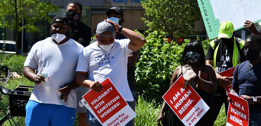 Four city workers and supporters rallying to link police brutality and the conditions that city workers face from their bosses.