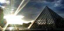 The Louvre's outside pyramid at sunset.